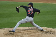 Cleveland Indians starter Shane Bieber delivers a pitch during the first inning of a baseball game against the Chicago White Sox Tuesday, April 13, 2021, in Chicago. (AP Photo/Paul Beaty)