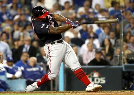 Washington's Howie Kendrick hits a grand slam in the 10th inning to lift the Nationals to a 7-3 victory over the Los Angeles Dodgers