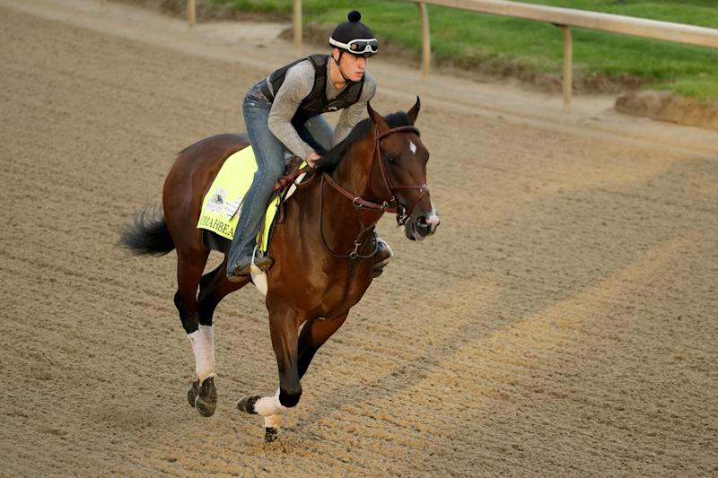 Exercise rider Taylor Cambra rides Kentucky Derby entrant Omaha Beach during a workout at Churchill Downs Wednesday, May 1, 2019, in Louisville, Ky. The 145th running of the Kentucky Derby is scheduled for Saturday, May 4. (AP Photo/Charlie Riedel)