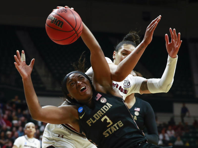 Florida State guard Sayawni Lassiter (3) battles for the ball with South Carolina defender Alexis Jennings, right, during the first half of a second-round women's college basketball game in the NCAA Tournament in Charlotte, N.C., Sunday, March 24, 2019. (AP Photo/Jason E. Miczek)