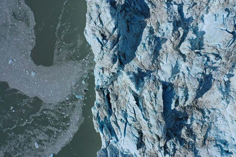 In this aerial view ice that has broken off from the Eqip Sermia Glacier, also called the Eqi Glacier, drifts away from the glacier's 200 meter tall face during unseasonably warm weather at Eqip Sermia, Greenland. (Photo: Sean Gallup/Getty Images)
