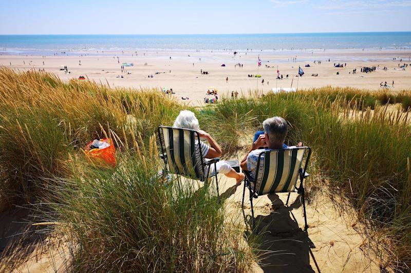 People enjoy the warm weather at Camber, East Sussex (PA)