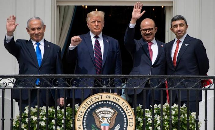 UAE Foreign Minister Abdullah bin Zayed Al-Nahyan stands on the far right of the White House balcony on September 15, 2020 as he signs a landmark accord to recognize Israel