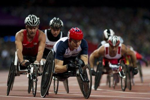 Britain's David Weir (C) competes in the men's 5,000m - T54