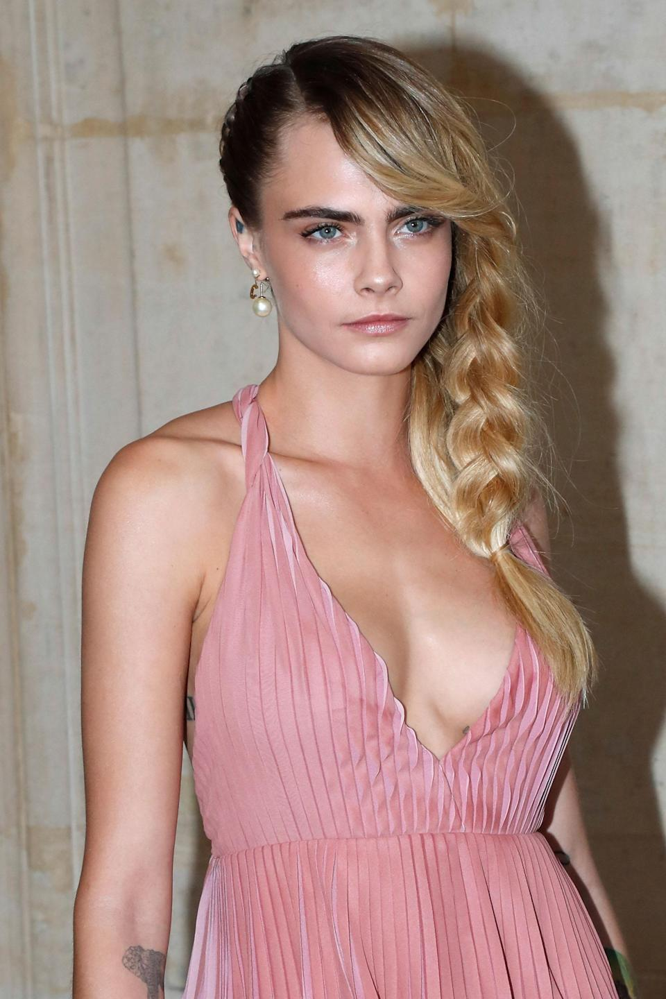 "<h3>Cara Delevingne</h3> <br>For one of the simplest ways to style a French braid, especially if you have lots of layers, make like <a href=""https://www.refinery29.com/en-us/2019/04/230398/cara-delevingne-armpit-hair-instagram-her-smell"" rel=""nofollow noopener"" target=""_blank"" data-ylk=""slk:Cara Delevingne"" class=""link rapid-noclick-resp"">Cara Delevingne</a> and start with a heavy side part. Wind the braid from above one ear around to your other shoulder, leaving out a few pieces or a heavy side bang to keep it looking casual.<span class=""copyright"">Photo: Bertrand Rindoff Petroff/Getty Images. </span><br>"