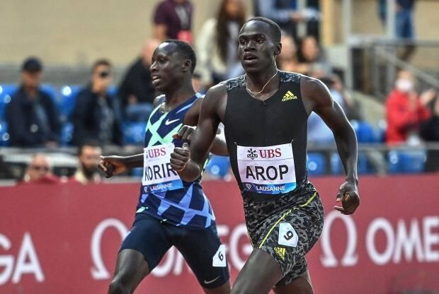 Canada's Marco Arop, right, defeated Kenya's Emmanuel Korir, left, in the men's 800-metre event of the IAAF Diamond League meet in Lausanne, Switzerland on Thursday. (Fabrice Coffrini/AFP via Getty Images - image credit)
