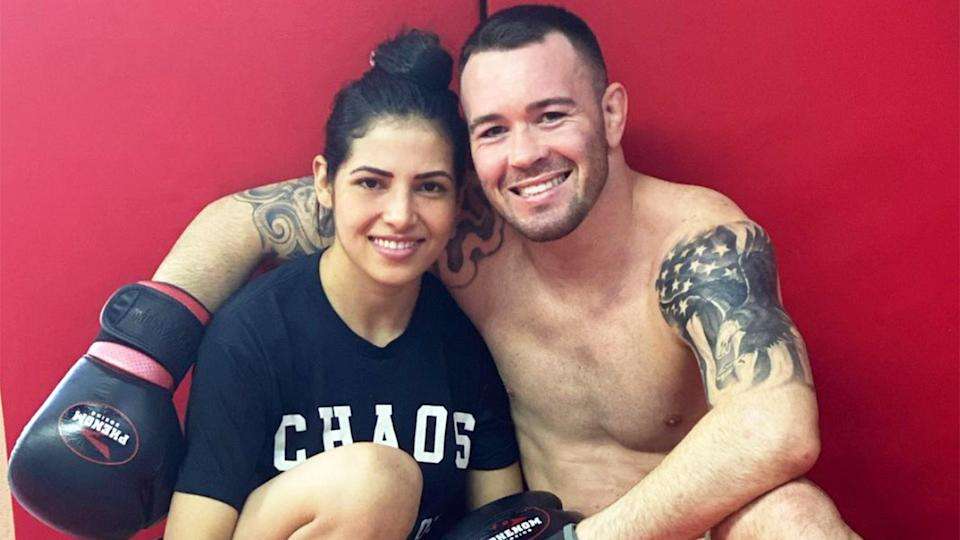 UFC fighter Polyana Viana (pictured left) smiles with welterweight contender Colby Covington's (pictured right).