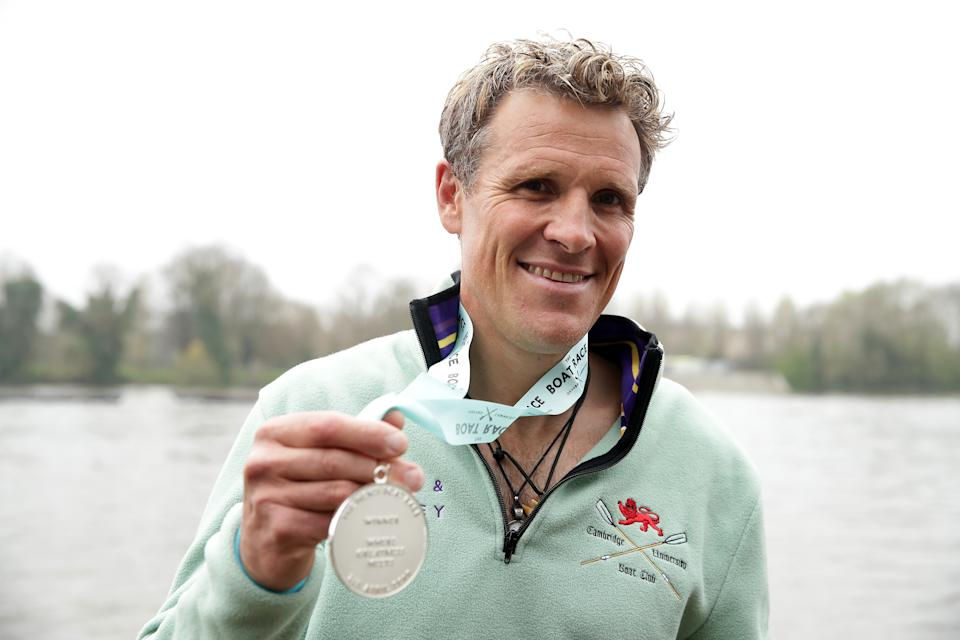 Cambridge's James Cracknell celebrates with his medal after the Men's Boat Race on the River Thames, London. (Photo by Adam Davy/PA Images via Getty Images)