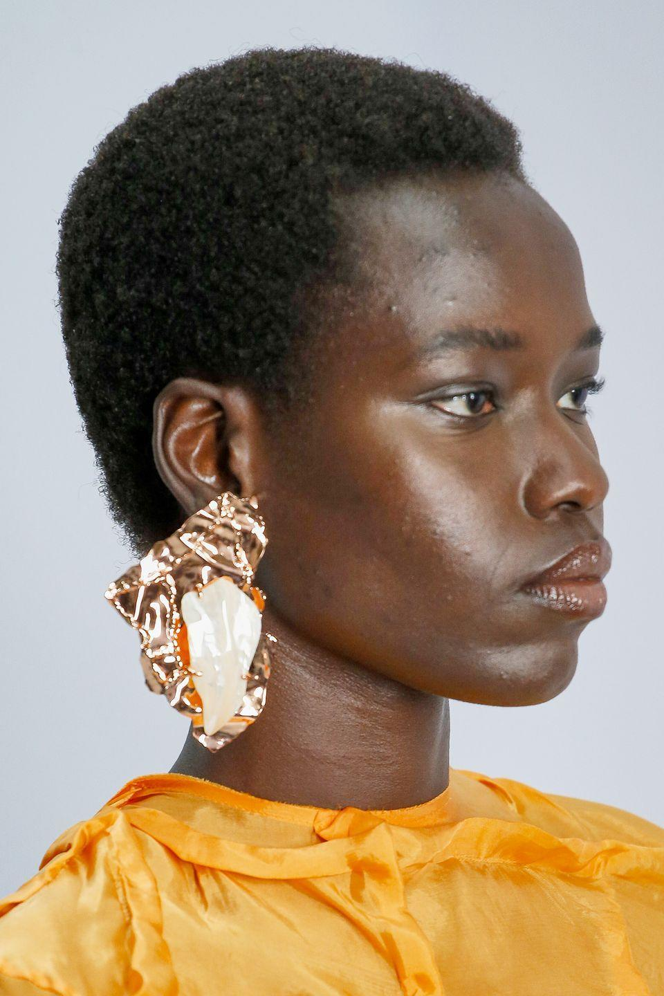 "<p>Trade in your smooth gold hoops for a textured pair. This season, designers swapped flat gold and silver pieces for rigid, ""crushed"" styles.<em><br></em></p><p><em>Acne </em></p>"