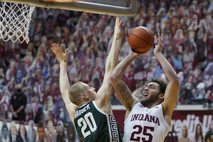 Indiana's Race Thompson (25) shoots over Michigan State's Joey Hauser (20) during the second half of an NCAA college basketball game, Saturday, Feb. 20, 2021, in Bloomington, Ind. Michigan State won 78-71. (AP Photo/Darron Cummings)