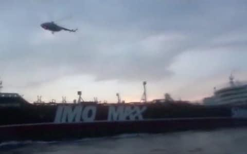 A helicopter hovers over British-flagged tanker Stena Impero near the strait of Hormuz - Credit: Reuters