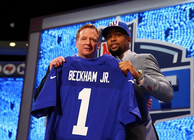 NEW YORK, NY - MAY 08: Odell Beckham Jr of the LSU Tigers poses with NFL Commissioner Roger Goodell after he was picked #12 overall by the New York Giants during the first round of the 2014 NFL Draft at Radio City Music Hall on May 8, 2014 in New York City. (Photo by Elsa/Getty Images)