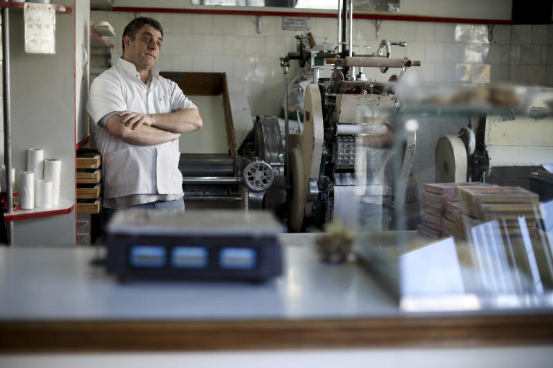 Alejandro Nigro stands at his pasta shop in Buenos Aires, Argentina, Tuesday, Aug. 13, 2019. Flour prices, the mainstay of Nigro's business, are expected to rise following the peso devaluation on Monday. (AP Photo/Natacha Pisarenko)