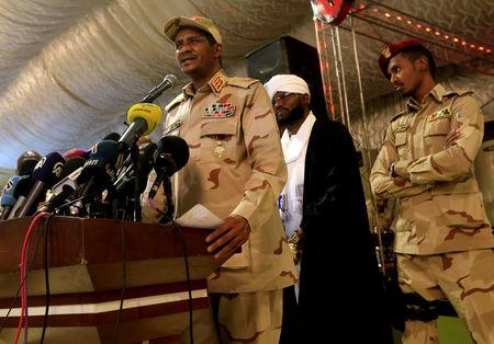 FILE PHOTO: General Mohamed Hamdan Dagalo, head of the Rapid Support Forces (RSF) and deputy head of the Transitional Military Council (TMC) delivers an address after the Ramadan prayers and Iftar organized by Sultan of Darfur Ahmed Hussain in Khartoum, Sudan May 18, 2019. REUTERS/Mohamed Nureldin Abdallah/File Photo