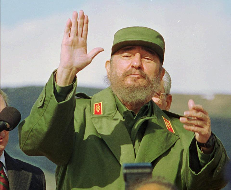 <p>Cuban President Fidel Castro waves to reporters Sunday, Oct. 15, 1995, upon his arrival at San Carlos de Bariloche, some 1,060 miles southwest of Buenos Aires, to attend the Ibero-American Summit which officially begins Monday. Education is the official summit subject. But Castro's presence is likely to prompt both condemnation of the U.S. trade embargo of the Caribbean island and calls for Castro to continue opening Cuba's socialist economy. (AP Photo/Jorge Saenz) </p>