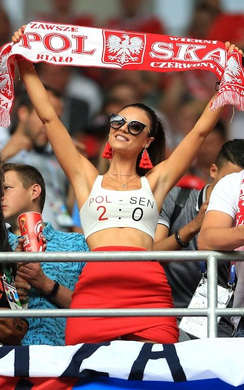 A woman with a crop top predicting the score as 2-0 Poland - Credit: OFFSIDE