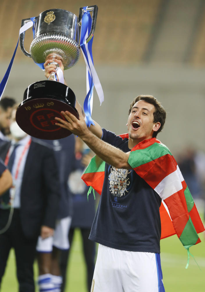 Real Sociedad's Mikel Oyarzabal, who scored the only goal, celebrates winning the final of the 2020 Copa del Rey, or King's Cup, soccer match between Athletic Bilbao and Real Sociedad at Estadio de La Cartuja in Sevilla, Spain, Saturday April 3, 2021. The game is the rescheduled final of the 2019-2020 competition which was originally postponed due to the coronavirus pandemic. (AP Photo/Angel Fernandez)