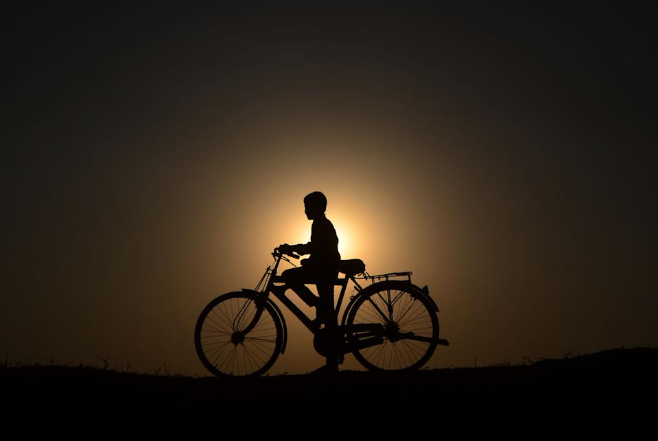 An indian cyclist takes rest near a parched area of shrunken Varuna River during a hot day , in Phoolpur village, some 45 kms from Allahabad on June 8, 2019. Much of India has been suffering from a heat wave for weeks along with a severe drought that has decimated crops, killed livestock and left at least 330 million Indians without enough water for their daily needs. (Photo by Ritesh Shukla ) (Photo by Ritesh Shukla/NurPhoto via Getty Images)