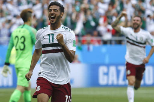 Mexico's Carlos Vela celebrates after scoring the opening goal during the group F match between Mexico and South Korea at the 2018 soccer World Cup in the Rostov Arena in Rostov-on-Don, Russia, Saturday, June 23, 2018. (AP Photo/Eduardo Verdugo)