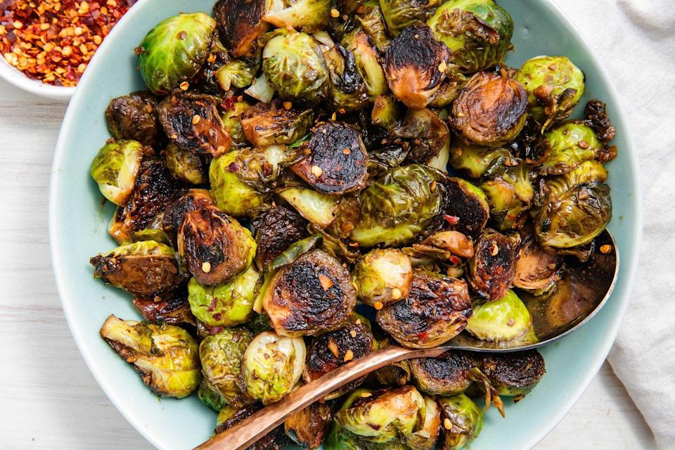 """<p>The hardest part of making these Brussels sprouts is leaving them alone. If you want that nice golden caramelisation, you gotta let those little guys cook undisturbed. You will be rewarded with sprouts that are both tender and crisp all at once. It's a game-changer! </p><p><br>Get the <a href=""""https://www.delish.com/uk/cooking/recipes/a28934268/honey-balsamic-glazed-brussels-sprouts-recipe/"""" rel=""""nofollow noopener"""" target=""""_blank"""" data-ylk=""""slk:Honey Balsamic Glazed Brussels Sprouts"""" class=""""link rapid-noclick-resp"""">Honey Balsamic Glazed Brussels Sprouts </a> recipe. </p>"""