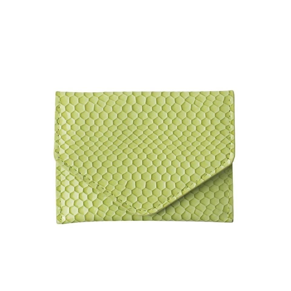 """Copenhagen-based Hvisk is a hidden gem of affordable handbags and accessories. Exhibit A: this lime green, snakeskin-effect wallet, which will be easy to find in your purse and clocks in at only $29. $29, HVISK. <a href=""""https://us.hvisk.com/collections/wallets/products/wallet-boa-wallet-green"""" rel=""""nofollow noopener"""" target=""""_blank"""" data-ylk=""""slk:Get it now!"""" class=""""link rapid-noclick-resp"""">Get it now!</a>"""
