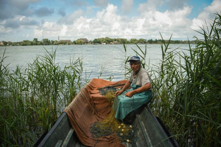 Fisherman Iosif Acsente,74, says he knows the Danube delta like the back of his hand (AFP Photo/Daniel MIHAILESCU)