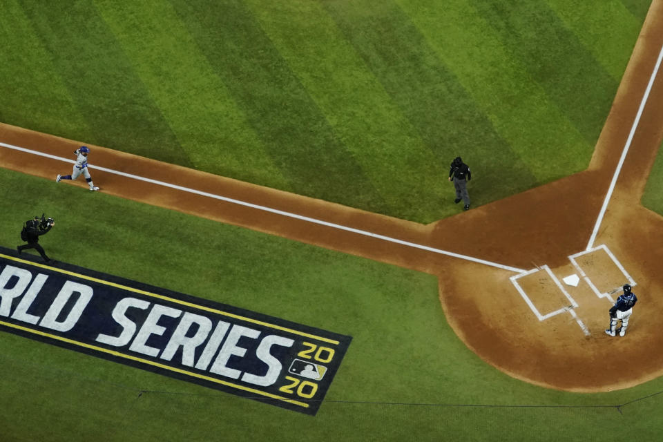 Los Angeles Dodgers' Justin Turner rounds the bases after a home run against the Tampa Bay Rays during the first inning in Game 4 of the baseball World Series Saturday, Oct. 24, 2020, in Arlington, Texas. (AP Photo/David J. Phillip)
