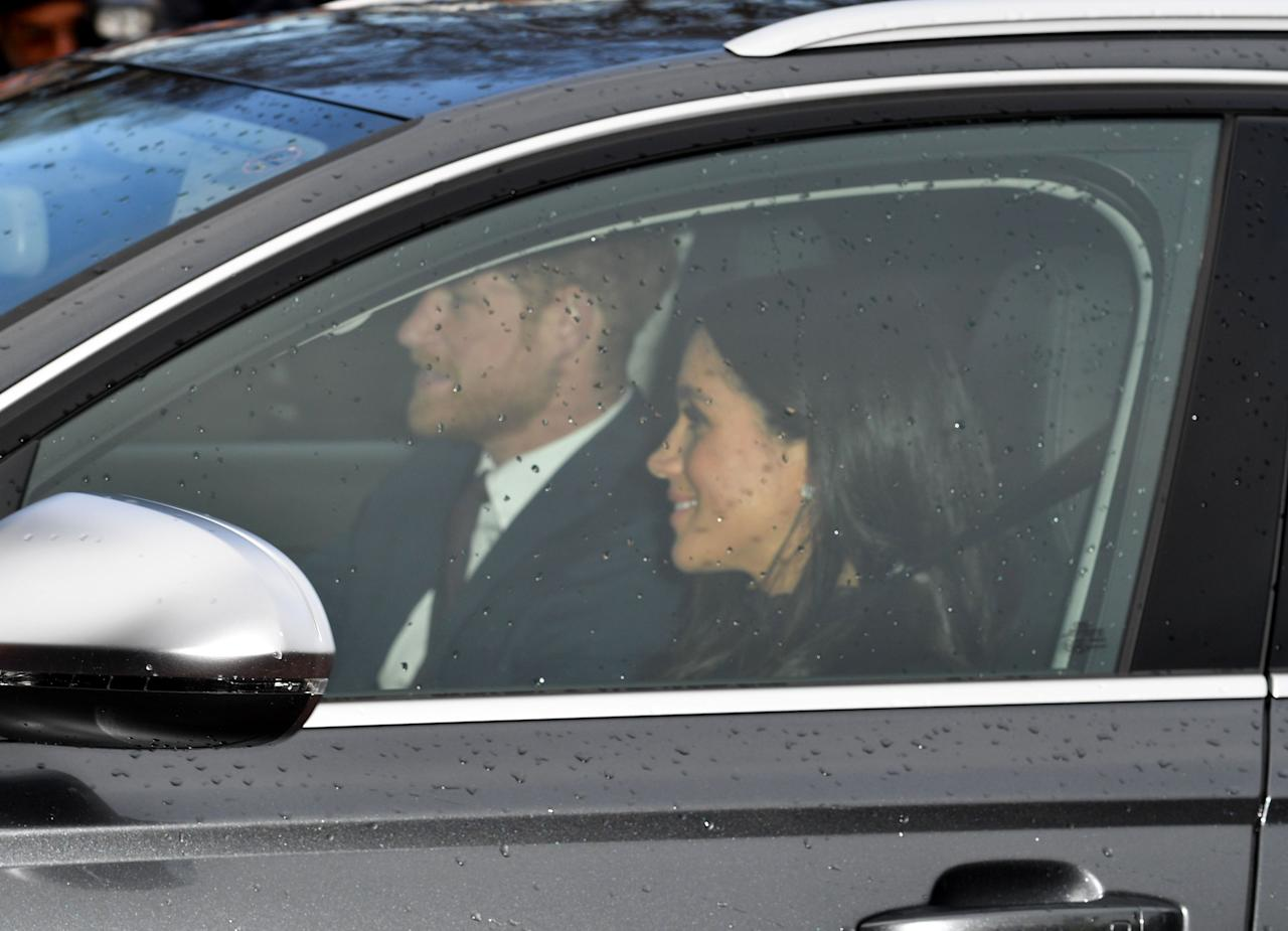 <p>The Duke and Duchess of Sussex smile as they drive to lunch [Photo: Rex] </p>