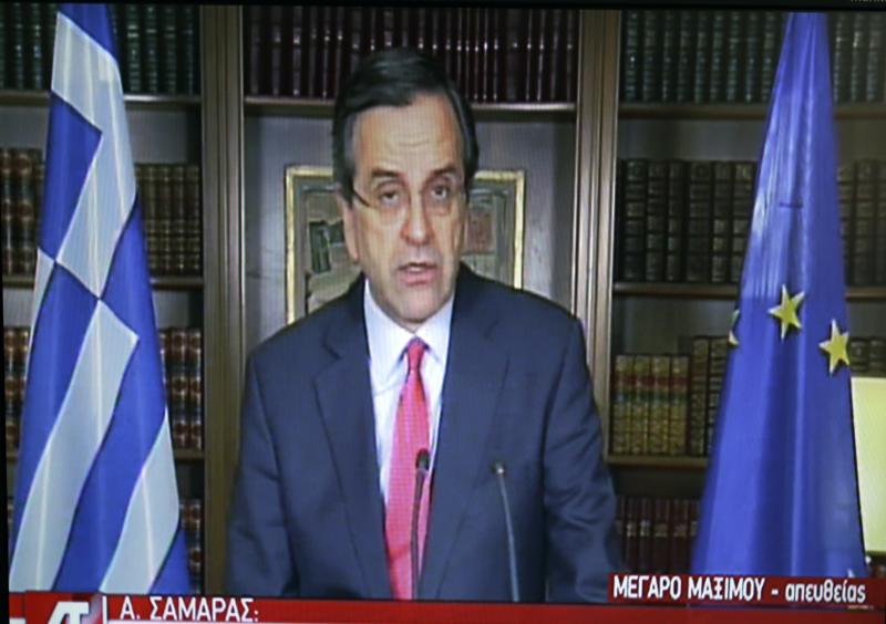 """In this image taken from State TV Greece's Prime Minister Antonis Samaras makes a statement to the Greek people from his office in Athens,Thursday, April 10, 2014. """"The reception of the five-year bond has exceeded all expectations,"""" Samaras said in a televised statement. """"All this means that international markets have expressed, beyond any possible doubt, their confidence in the Greek economy."""" The banner on the screen reads in Greek ''Maximos Mansion Live, A. Samaras.'' (AP Photo/Thanassis Stavrakis)"""