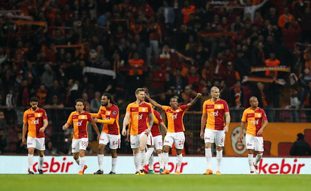 Soccer Football - Turkish Super League - Galatasaray vs Basaksehir - Turk Telekom Arena, Istanbul, Turkey - April 15, 2018 Galatasaray's Garry Rodrigues and team mates celebrate at the end of the match REUTERS/Murad Sezer