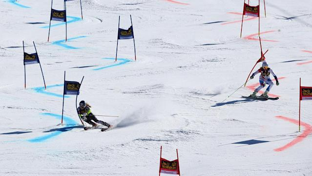 Second placed, Mikaela Shiffrin of the united States, and first placed Switzerland's Denise Feierabend ski during an alpine ski, World Cup National team event, in Lenzerheide, Switzerland, March 14, 2014. (AP Photo/Marco Trovati)