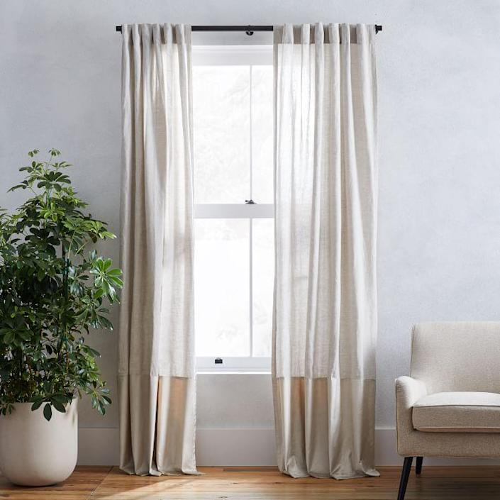 "When it comes to layering textures, this set from West Elm wins. These minimalist curtains effortlessly combine the relaxed feel of linen and the luxurious look of velvet. Elevate your living room with an unexpected mixture of materials that establishes a sophisticated sense of style. $99, West Elm. <a href=""https://www.westelm.com/products/linen-luster-velvet-curtain-natural-stone-t5902/?"" rel=""nofollow noopener"" target=""_blank"" data-ylk=""slk:Get it now!"" class=""link rapid-noclick-resp"">Get it now!</a>"