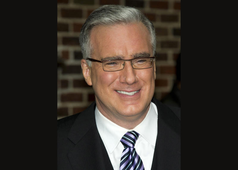 "FILE - In this Oct. 24, 2011 file photo, political pundit Keith Olbermann leaves a taping of the ""Late Show with David Letterman,"" in New York. Turner Sports said Wednesday, June 5, 2013, that it is hiring Olbermann to host its baseball studio show for the postseason. (AP Photo/Charles Sykes, file)"