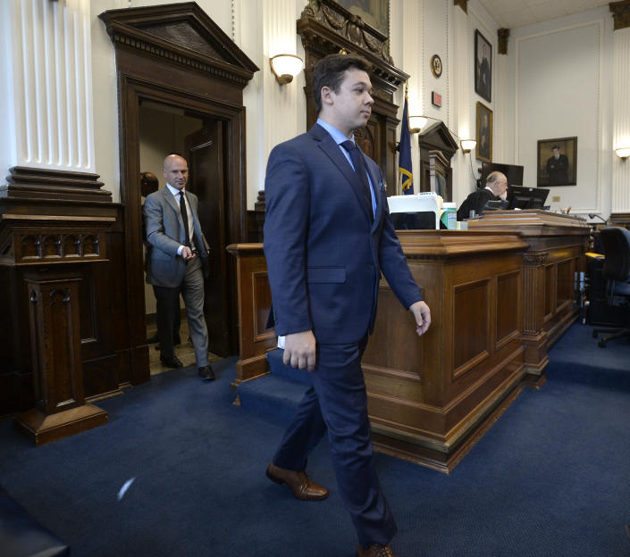 Kyle Rittenhouse, center, walks into the courtroom with attorney Corey Chirafisi for a motion hearing in Kenosha, Wis., on Friday, Sept. 17, 2021. (Sean Krajacic/The Kenosha News via AP)