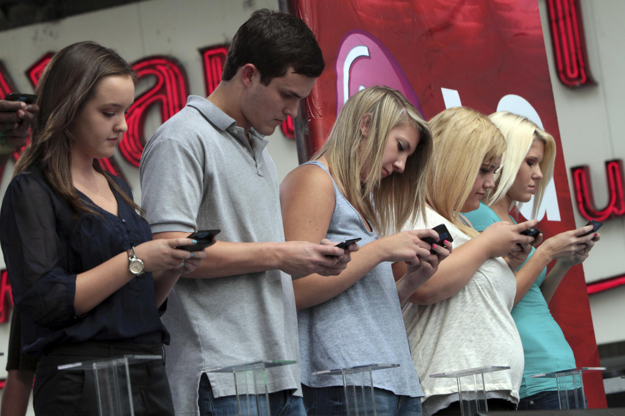 Contestants compete during the 2012 LG U.S. National Texting Championship, Wednesday, Aug. 8, 2012 in New York. (AP Photo/Mary Altaffer)