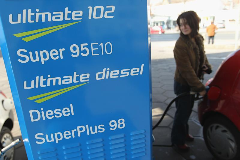 BERLIN, GERMANY - MARCH 04: A young woman fills her car's gasoline tank with Super 95 E10 gasoline at a petrol station on March 4, 2011 in Berlin, Germany. Members of Germany's association of petroleum producers announced the day before that they would stop deliveries of Super E10, which is a blend of gasoline and 10% ethanol, because stockpiles are too high and consumers are not buying enough of it. (Photo by Sean Gallup/Getty Images)