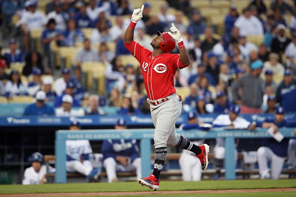LOS ANGELES, CA - APRIL 15: Yasiel Puig #42 of the Cincinnati Reds reacts after hitting a home run in the first inning during the game between the Cincinnati Reds and the Los Angeles Dodgers at Dodger Stadium on Monday, April 15, 2019 in Los Angeles, California. (Photo by Rob Leiter/MLB Photos via Getty Images)