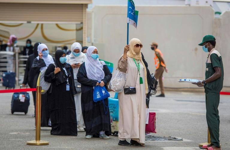 A first trickle of pilgrims arrives at Mount Arafat outside Mecca for a day of Koran recitals and prayers to atone for their sins that is the climax of the hajj