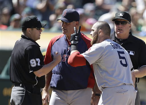 Boston Red Sox manager John Farrell, second from left, and Boston's Jonny Gomes (5) argue with home plate umpire Todd Tichenor, left, in the ninth inning of a baseball game against the Oakland Athletics on Sunday, July 14, 2013, in Oakland, Calif. (AP Photo/Ben Margot)