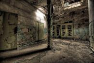 <p>Beams of light from above illuminate this old hospital basement - a place you surely wouldn't want to be a night.</p>
