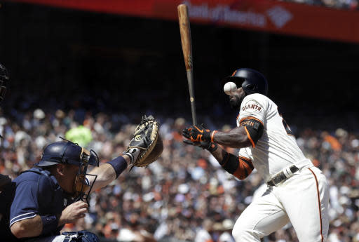San Francisco Giants' Andrew McCutchen is hit by a pitch during the seventh inning of the team's baseball game against the San Diego Padres on Saturday, June 23, 2018, in San Francisco. (AP Photo/Marcio Jose Sanchez)