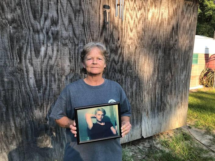 """Sandy Smith holds a photo of her late son, 19-year-old Stephen Smith, on June 24, 2021. """"There will never be another one like him,"""" she said."""