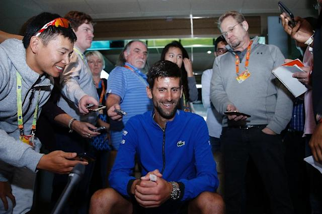 Novak Djokovic answers questions Wednesday ahead of the start of the ATP Miami Open (AFP Photo/Michael Reaves)