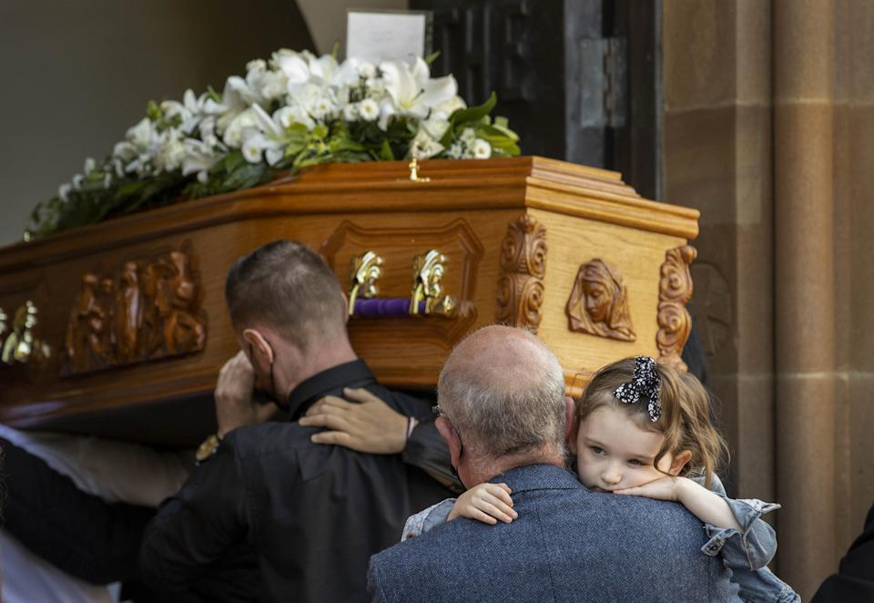 The daughter of Samantha Willis (nee Curran), Lilyanna, is carried into St Columb's Church, Londonderry, behind the coffin for the funeral for the mother-of-four from Strathfoyle who died with Covid-19 shortly after giving birth on Friday. Picture date: Monday August 23, 2021.