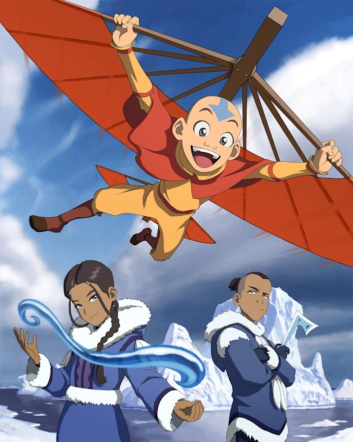 """Aang, the last living Air nomad, glides above his friends Katara and Sokka from the Southern Water tribe. <span class=""""copyright"""">(Nickelodeon)</span>"""