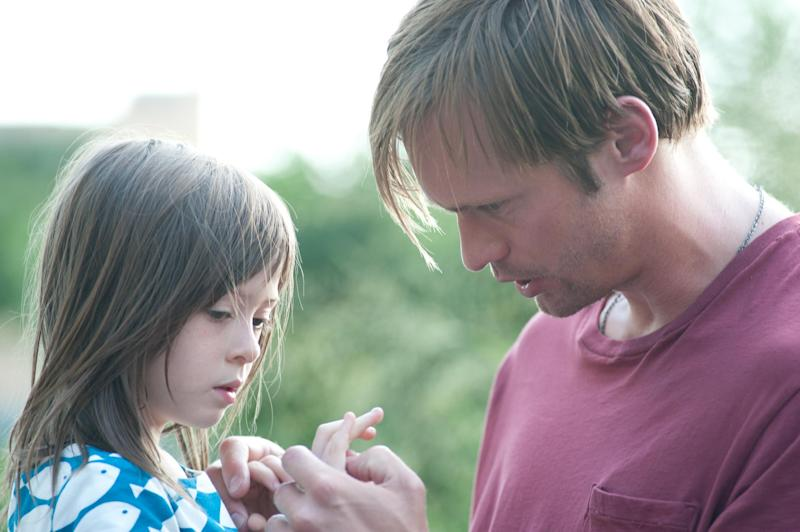 "This film image released by Millennium Entertainment shows Onata Aprile, left, and Alexander Skarsgard in a scene from ""What Maisie Knew.""  (AP Photo/Millennium Entertainment, JoJo Whilden)"