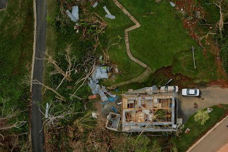 The contents of a damaged home can be seen as recovery efforts continue following Hurricane Maria near the town of Comerio, Puerto Rico, October 7, 2017. REUTERS/Lucas Jackson