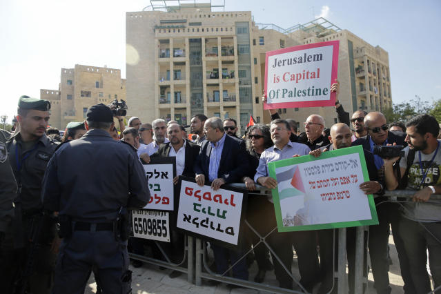 Israeli Arab Knesset members and left wing activists participate in protest against the opening of the new US embassy in Jerusalem, during the embassy's official inauguration ceremony, Monday, May 14, 2018. Amid deadly clashes along the Israeli-Palestinian border, President Donald Trump's top aides and supporters on Monday celebrated the opening of the new U.S. Embassy in Jerusalem as a campaign promised fulfilled. (AP Photo/Mahmoud Illean)