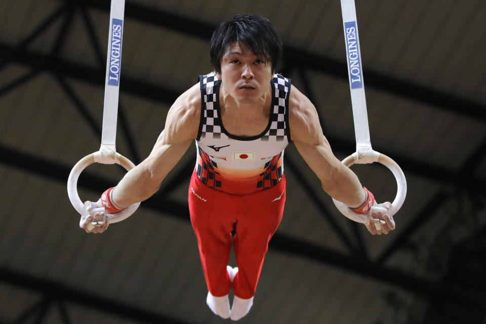 FILE - In this Oct. 29, 2018, file photo, Japan's Kohei Uchimura performs on the rings during the men's team final of the Gymnastics World Championships at the Aspire Dome in Doha, Qatar. Japan's Kyodo news agency has reported that Uchimura has tested positive for COVID-19 and comes just over a week before an international gymnastics meet that will test countermeasures against the coronavirus. (AP Photo/Vadim Ghirda, File)