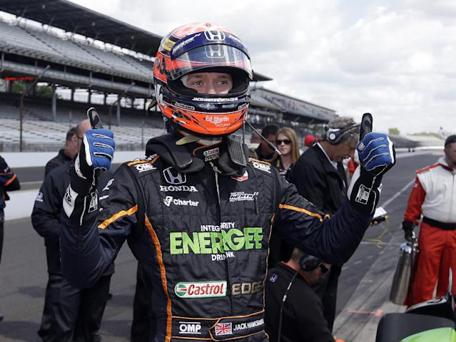 Jack Hawksworth, of England, signals his pleasure with his speed after he qualified on the first day of qualifications for Indianapolis 500 IndyCar auto race at the Indianapolis Motor Speedway in Indianapolis, Saturday, May 17, 2014. (AP Photo/Darron Cummings)